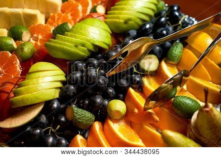 Fresh Fruits Background With Pomegranate, Oranges, Grapes, Apples On Tray