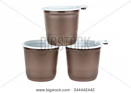 Pyramid Of Three Unused Disposable White Plastic Mugs With Brown Satin Texture On The Outside Isolat