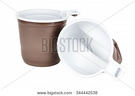 New And Crumpled Unused Disposable White Plastic Mugs With Brown Satin Texture On The Outside Isolat