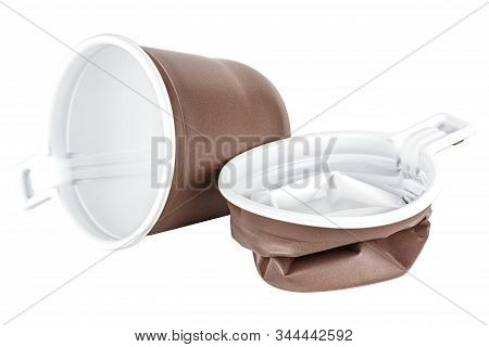 New And Crushed Unused Disposable White Plastic Mugs With Brown Satin Texture On The Outside Isolate