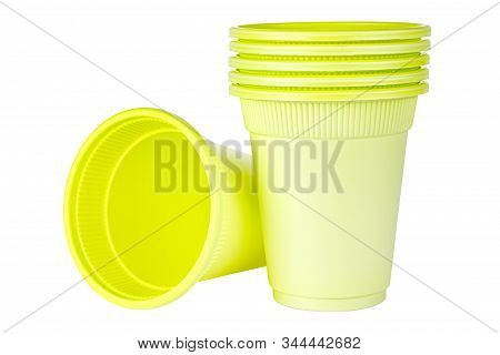 Lying One And Standing Five In Set Unused Green Disposable Cups Made Of Biodegradable Materials Isol