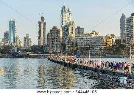 Mumbai, India - February 27, 2019: Indian People Go To Haji Ali Dargah Mosque And Tomb On Islet Off