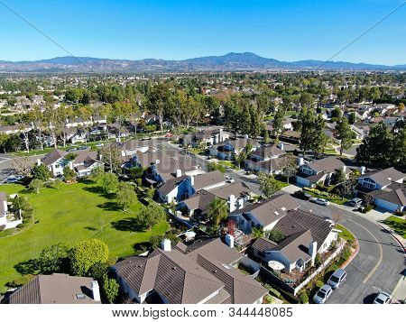 Aerial View Of Residential Suburban Packed Homes Neighborhood During Blue Sky Day In Irvine, Orange