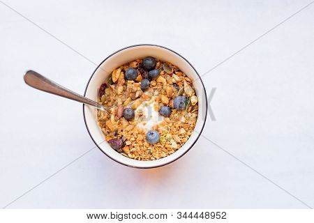Bowl Of Muesli And Yogurt With Fresh Berries. Diet Dessert With Yogurt, Granola And Fresh Berries, B