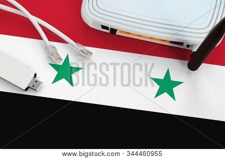 Syria Flag Depicted On Table With Internet Rj45 Cable, Wireless Usb Wifi Adapter And Router. Interne