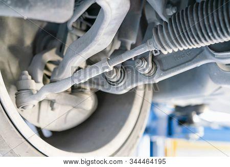 Car Bottom View Wishbone Power Steering Rack Arm Suspension And Etc System Of Saloon Or Sedan Car At