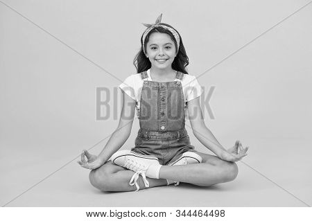 Get Comfortable And Prepare To Meditate. Little Child Meditate In Healthy Pose. Small Girl Learn To