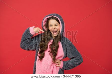 Beautiful Me. Happy Girl Point Finger Red Background. Small Girl Wear Soft Pajamas. Cute Girl Child