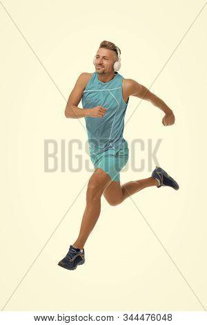 Keep Running. Feel The Rhythm. Motivational Song. Man Sportsman Running With Headphones. Runner Hand