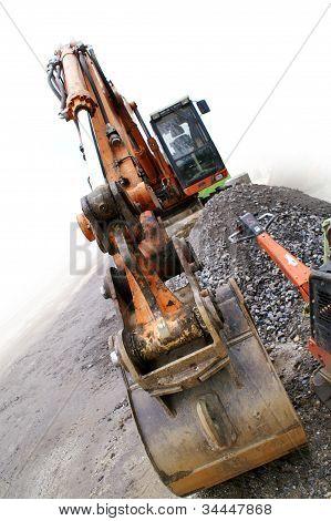 Excavator With Bucket