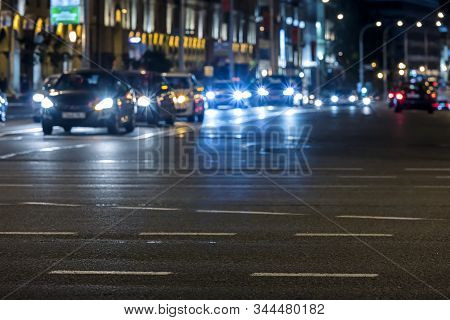 Colorful Lights Of Car Traffic At Night. City Street With Driving Cars. Motion Blur
