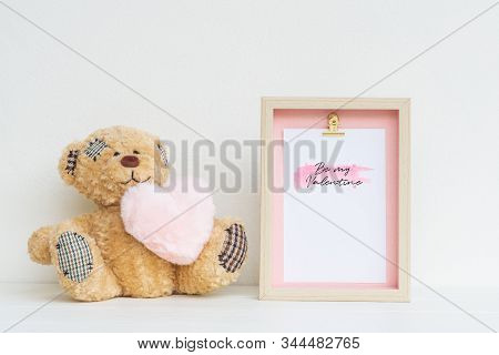 Mockup Picture Frame And Cute Bear With Pink Heart. Valentines Day Background Concept With Copy Spac