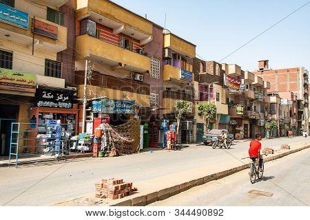 Edfu, Nile River Egypt 19.05.2018 Town Street Cafeteria And Shops On The Main Street In Edfu City