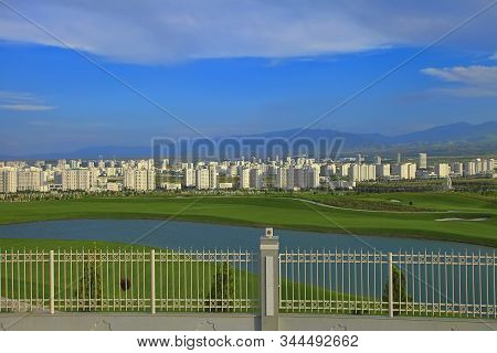 Ashgabat, Turkmenistan. View Of The New Neighborhood On A Background Of Mountains.