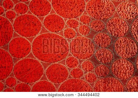 Red Colored Fabric With Geometric Design And Woolly Texture