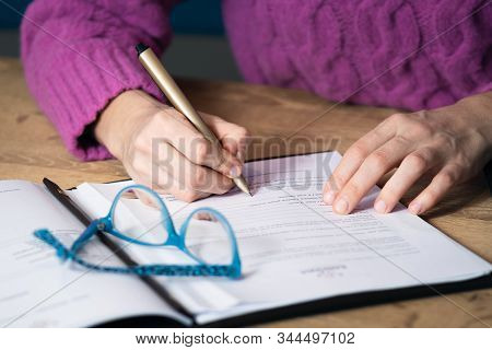 Businesswoman Hand Signing Document. Close Up Of Businesswoman Signing Contract Document. Business P