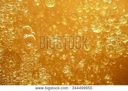 Golden Yellow Bubble Oil Droplet, Abstract Background