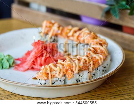 Japanese Rolls With Tobiko Caviar On A Plate With Pickled Ginger And Wasabi On A Restaurant Table. R