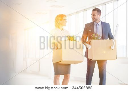 Business poeple carrying boxes while walking and relocating to new office