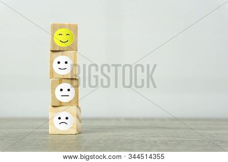 Conceptual The Customer Responded To The Survey. A Wooden Cube With Face Symbol On Wooden Table. Dep