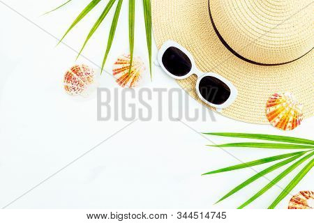 Travel. Feminine White  Sunglasses And Straw Hat On White Background. Copy Space