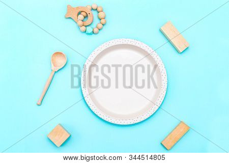 Baby Bamboo Plate And Wooden Spoon Beige Color With Baby Wooden Toys, Sustainable Lifestyle. Reusabl