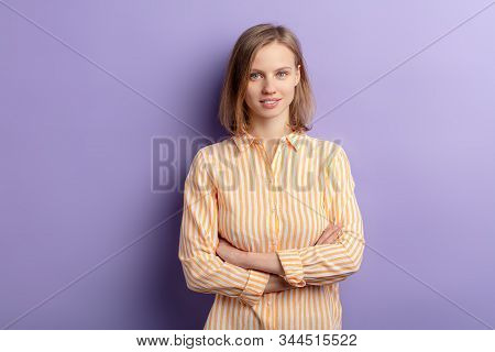 Adorable Caucasian Woman Look At Camera And Smile Isolated Over Purple Background, Wearing Casual Cl