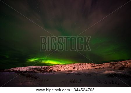 Hills, Clear Starry Sky And Colorful Northern Lights, An Incredible Natural Phenomenon