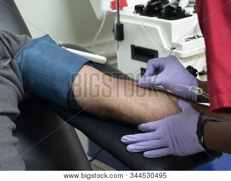 A Fireman From The New Bern ,north Carolina Fire Dept Rolls Up His Sleeve And Donates Blood In The B