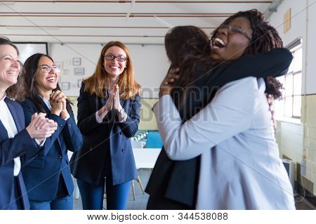Coworkers Greeting Female Colleague In Office. Group Of Happy Multiethnic Coworkers Clapping Hands A