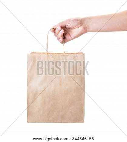 Hand Holding A Paper Bag On A White, Isolated.