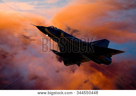 A Composite Image Of A Fighter Jet Aircraft Silhouette Against Orange Clouds