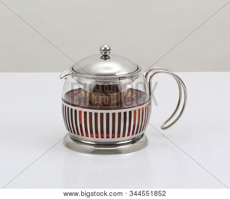 Glass Teapot With Tea Ready To Serve Isolated On White Background