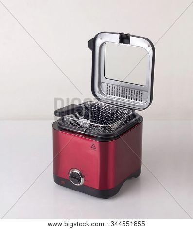 Empty Red Deep Fryer Machine, Modern Kitchenware, Isolated On White Background