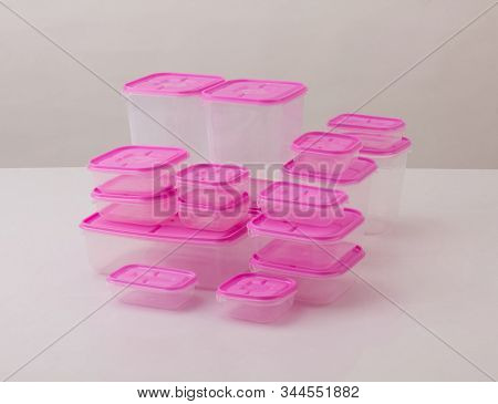 Set Of Pink Plastic Boxes Isolated On White Background