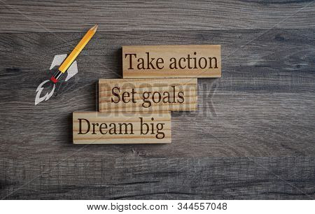 Wooden Blocks With Business Terms Dream Big, Set Goals And Take Action On Wooden Background With Roc