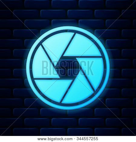 Glowing Neon Camera Shutter Icon Isolated On Brick Wall Background. Vector Illustration