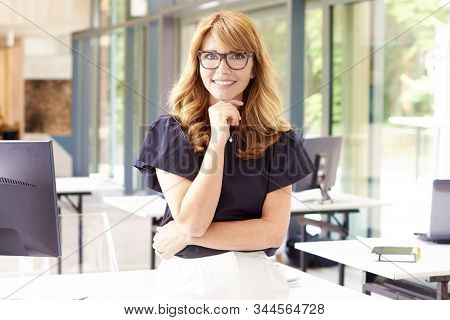 Attractive Mature Businesswoman Portrait In The Office