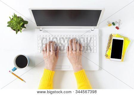 Topview Businesswoman Hands On White Desk In The Office With Laptop.