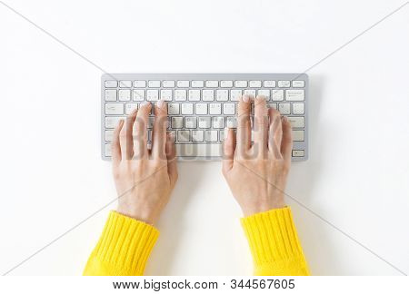 Top View On Female Elegant Hands On A Computer Keyboard. Isolated White Background And Clipping Path