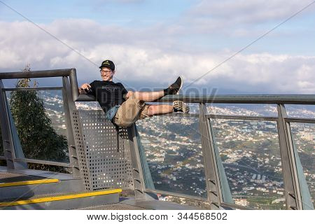 Cabo Girao, Madeira, Portugal - April 18, 2018: A Man Showing Off His Girlfriend On The Railing Of T