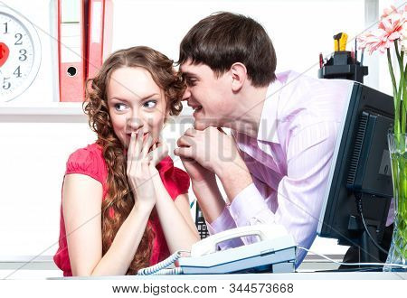 A Young Male Employee Of The Company Gave Flowers And Shows Courtship To His Colleague-a Young Woman