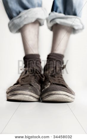 Legs With Pair Of Shoes On Them