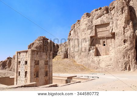 Royal tombs and Cube of Zoroaster (Ka'ba-ye Zartosht ) in ancient necropolis Naqsh-e Rustam, Achaemenid dynasty, Fars province, Iran. UNESCO world heritage site
