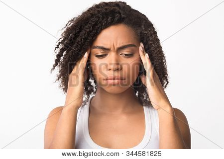 Headache Concept. Black Woman Touching Her Temples, Suffering From Migraine, Stress, Copyspace, Whit