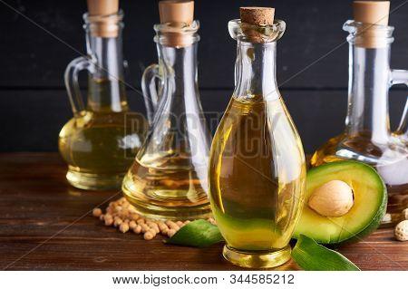 Healthy Vegetable Oils In Glass Bottles. Avocado Oil, Chickpea Oil, Linseed Oil, Peanut Oil, Almond