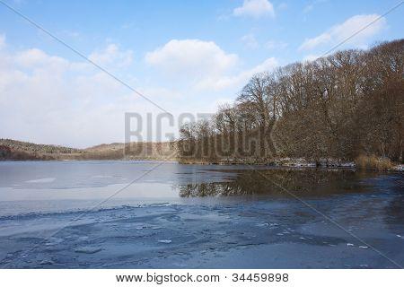 Frozen lake at Ainu village, Hokkaido, Japan