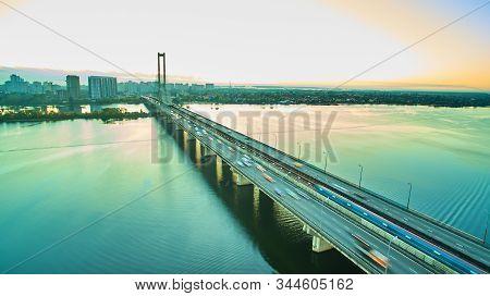 Traffic On A Bridge. Modern Metropolis With Intersection Of The Traffic Trails On A Bridge. Traffic