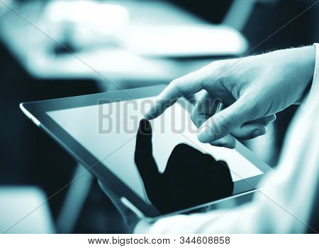 Hand Touching Digital Touch Pad. Technology And Communication Concept.