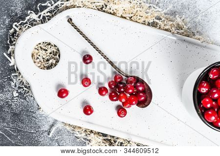 Ripe Red Cranberries In An Iron Mug. Gray Background. Top View
